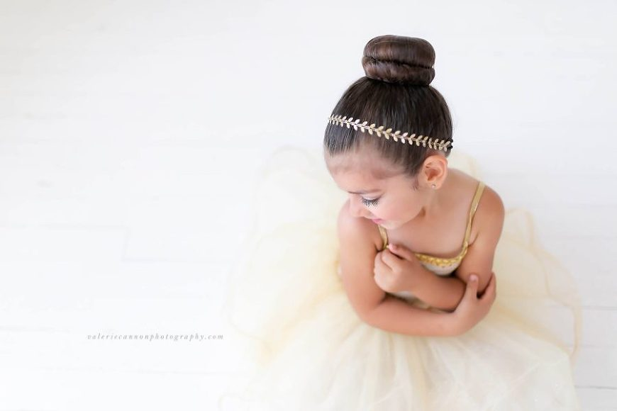 Overhead shot of ballerina dressed in gold, Daily Fan Favorite on Beyond the Wanderlust