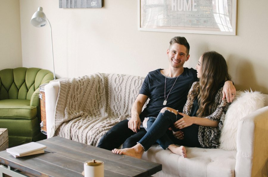 Man smiling on the couch with his wife, Nashville Lifestyle Couples Session