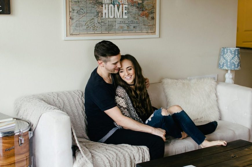 Man and woman snuggled up on couch together, Nashville Lifestyle Couples Session