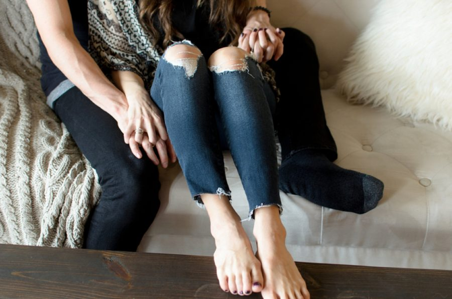 Woman sitting on couch with feet on coffee table, Jeans with holes in the knees, Nashville Lifestyle Couples Session