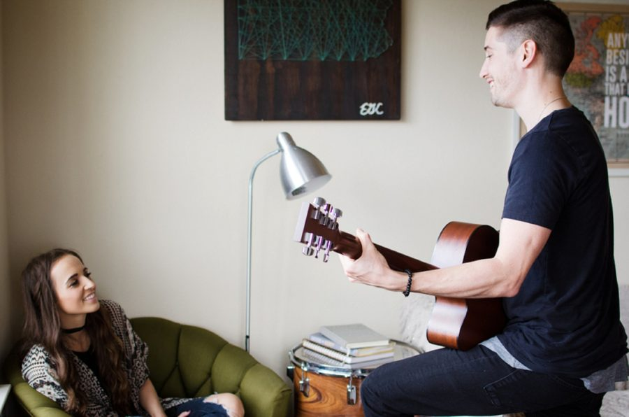 Man serenading woman with guitar, Nashville Lifestyle Couples Session