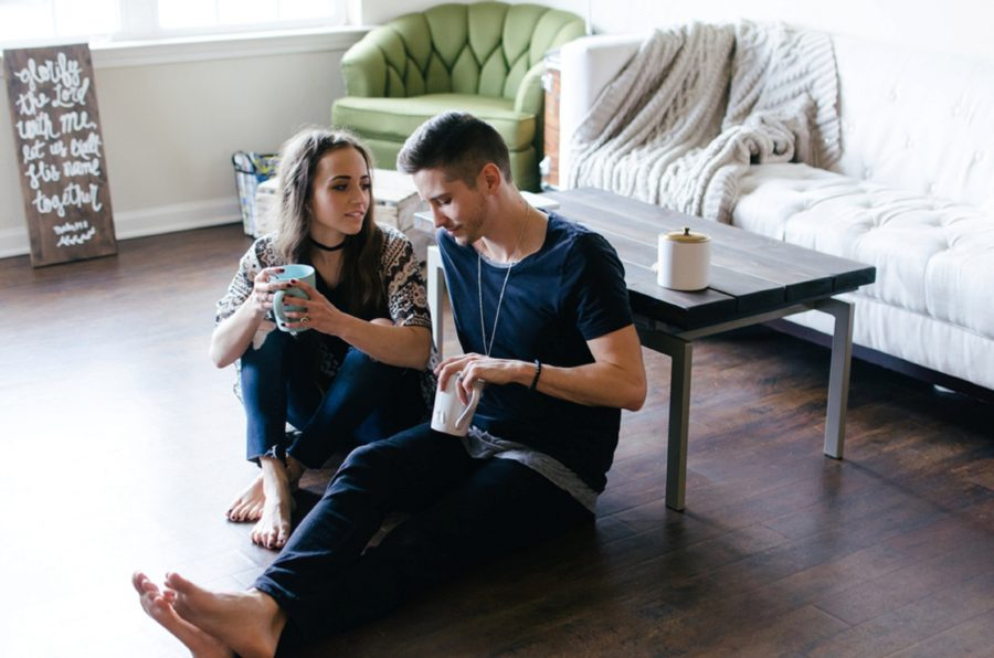 Couple sitting on floor in living room with mugs, Nashville Lifestyle Couples Session