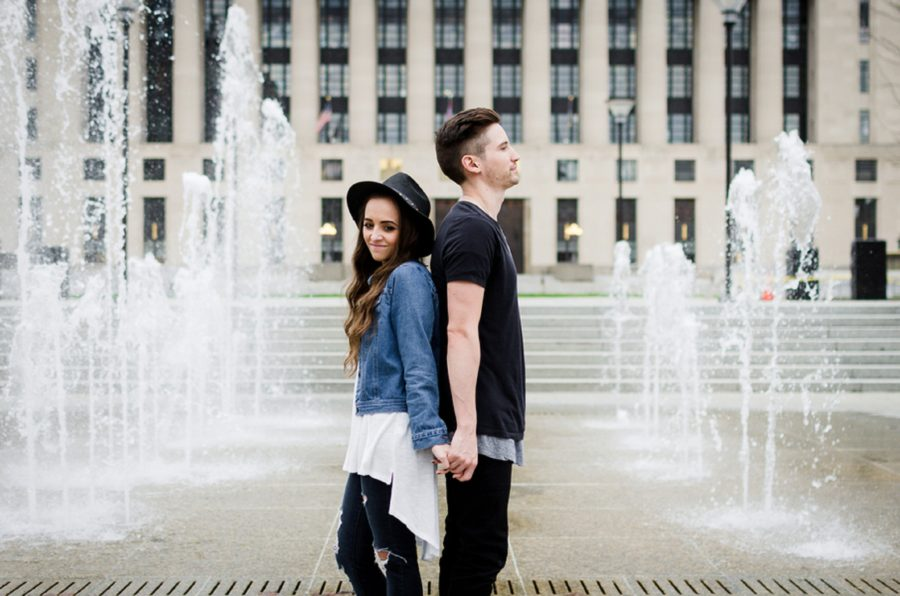 Couple standing back to back in front of water fountains, Downtown Nashville fountains, Nashville Lifestyle Couples Session