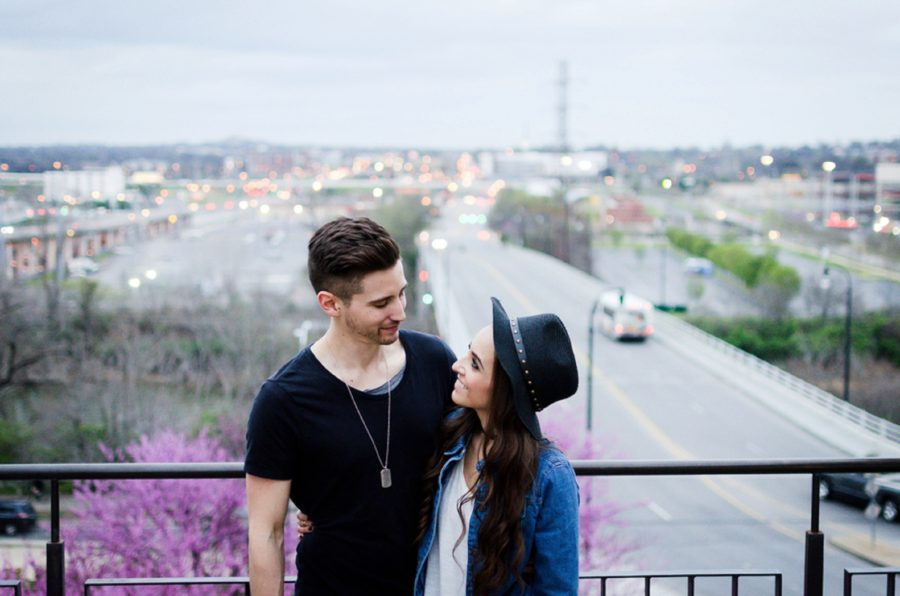 Couple smiling at each other with city in background, Nashville Lifestyle Couples Session