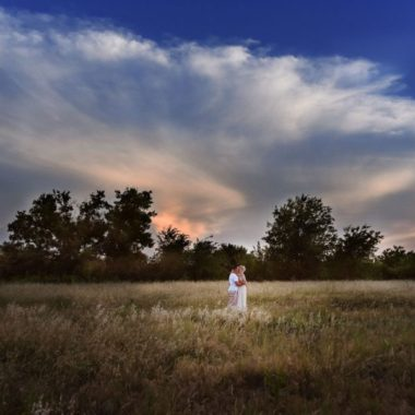 Couple standing in field together with beautiful sky behind them, Jeanine Phelps Photography Daily Fan Favorite
