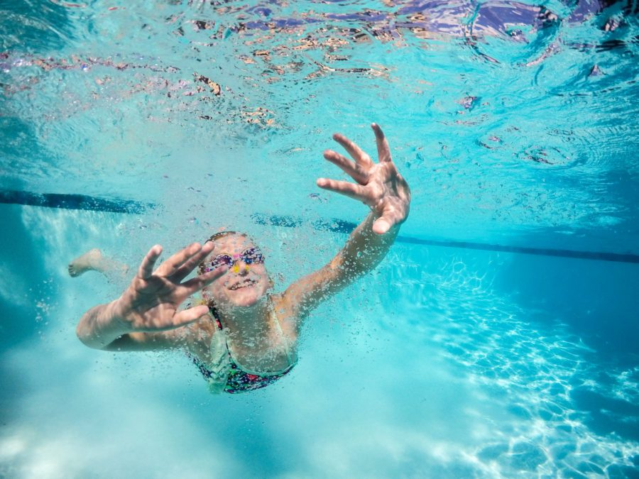 Girl swimming under water, underwater photography, Daily Fan Favorites on Beyond the Wanderlust