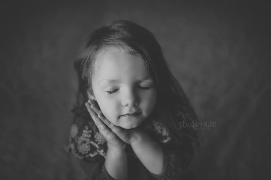 Black and white portrait of young girl, girl with face resting on hands, Daily Fan Favorites on Beyond the Wanderlust