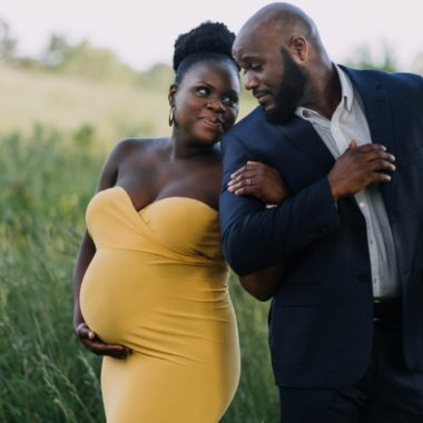 Couple dressed up posing for maternity pictures, Classy Outdoor Maternity Session in Philadelphia