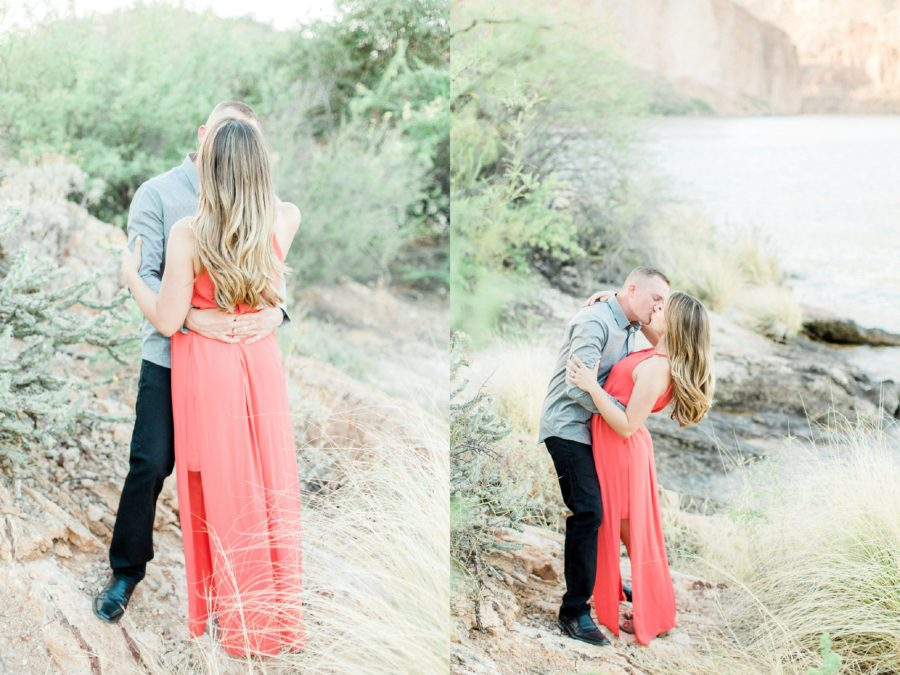Man and woman kissing by lake shore, Man dipping woman back for kiss, Canyon Lake Engagement Pictures in Arizona