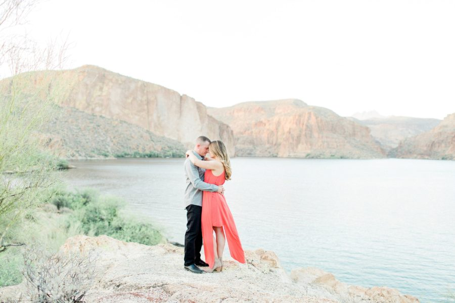 Couple touching foreheads, coral dress for engagement photos, Canyon Lake Engagement Pictures in Arizona
