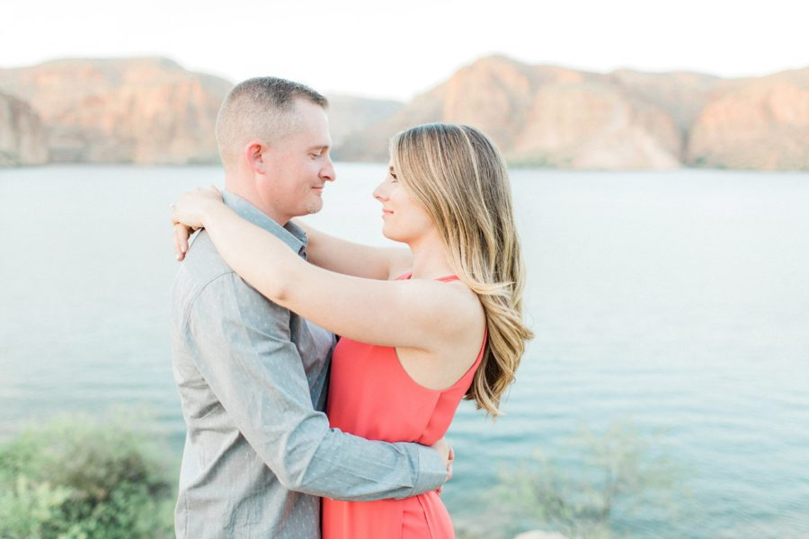 Couple looking in to each others eyes with arms wrapped around each other, Canyon Lake Engagement Pictures in Arizona