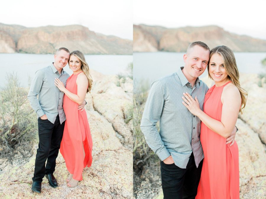 Couple smiling for engagement pictures, Woman with hand resting on man