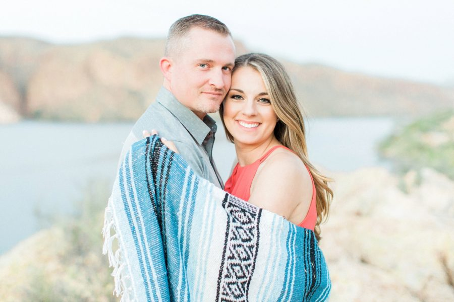 Couple wrapped in blanket together, Canyon Lake Engagement Pictures in Arizona