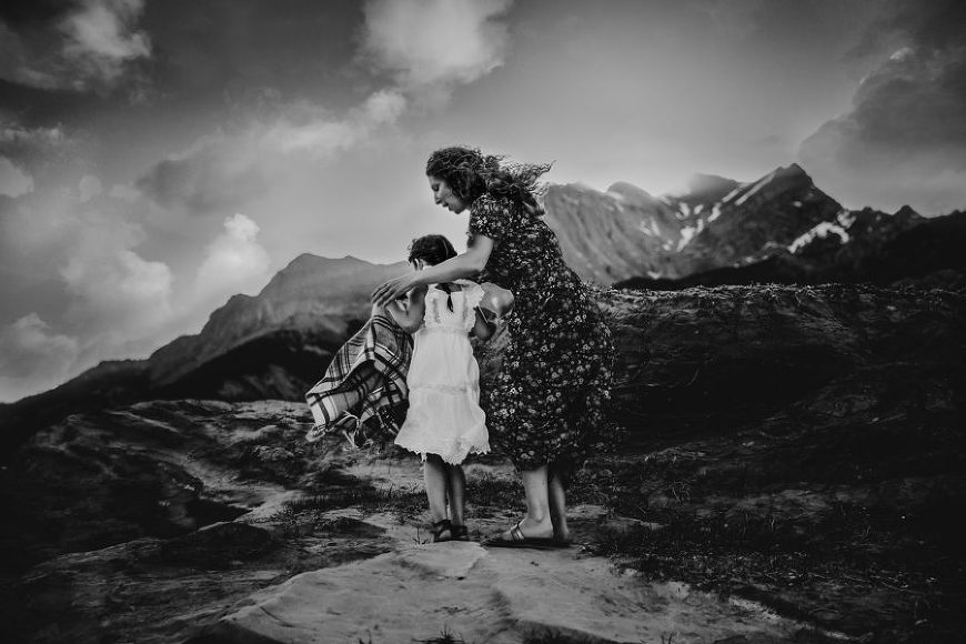 Woman and child walking with mountains in background, Daily Fan Favorite Bree Friesen Photography