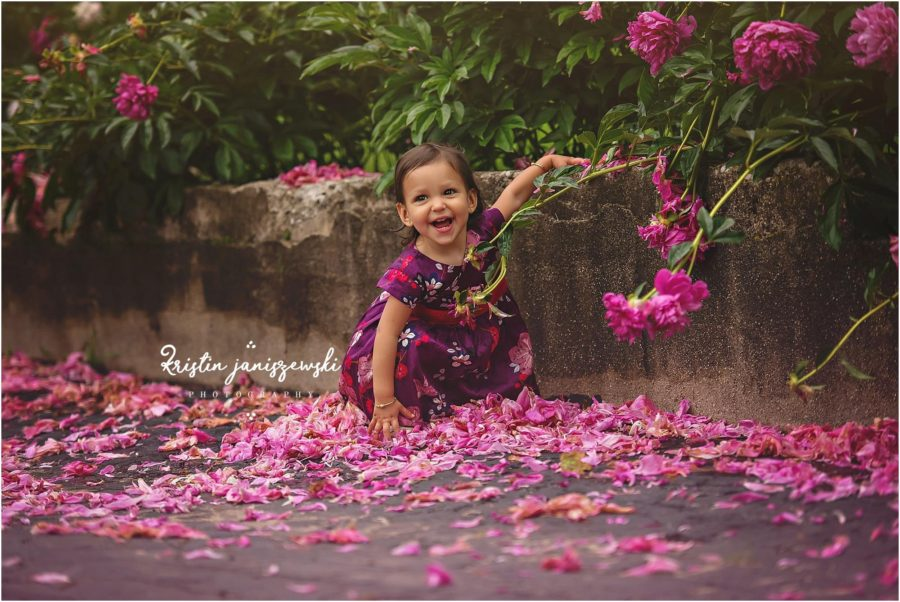 Girl by pink flower blooms, Beyond the Wanderlust Daily Fan Favorites