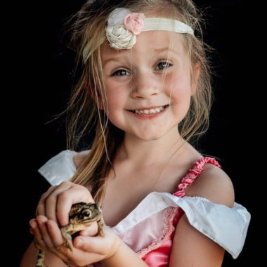 Girl dressed as princess holding frog, Chani Gunn Photography Daily Fan Favorite