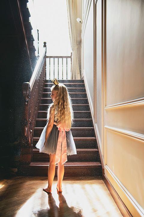 Girl standing in indoor rim light, Daily Fan Favorites on Beyond the Wanderlust