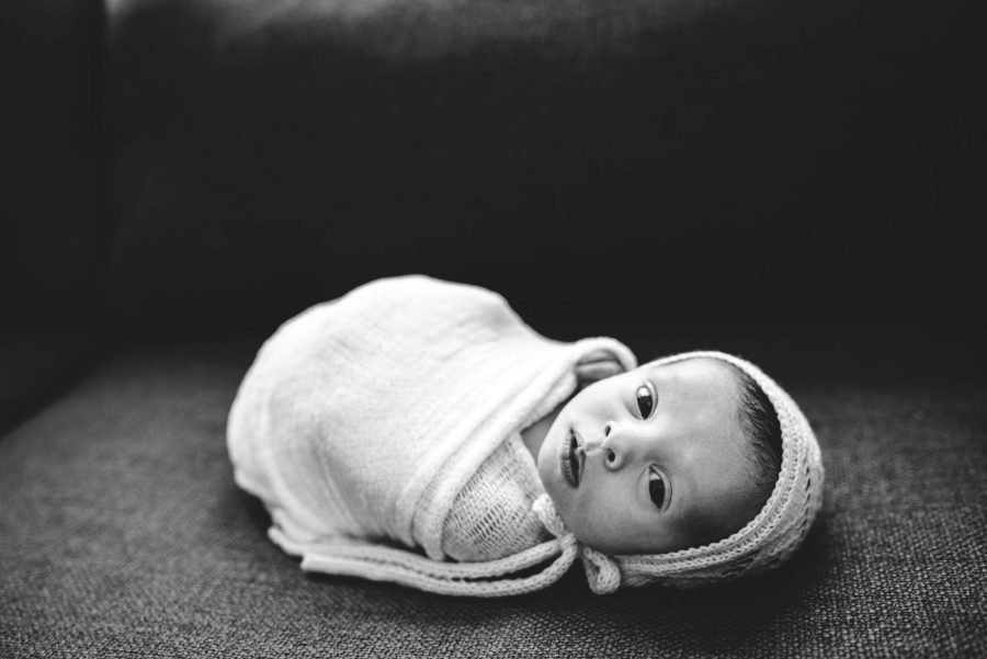 Baby wrapped up lying on couch, Beautiful In-Home Newborn Pictures