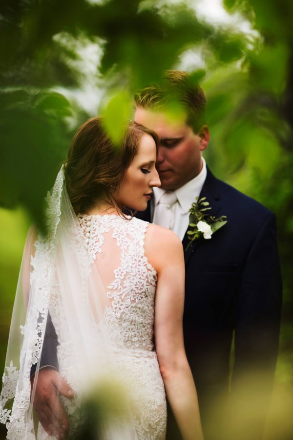 Portrait of bride and groom through leaves, Daily Fan Favorites on Beyond the Wanderlust