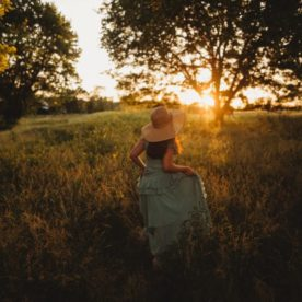 Girl walking through field at sundown, Heather Marshall Photography Daily Fan Favorite