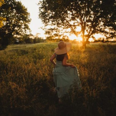 Girl walking through field at sundown, Heather Marshall Photography Daily Fan Favorite