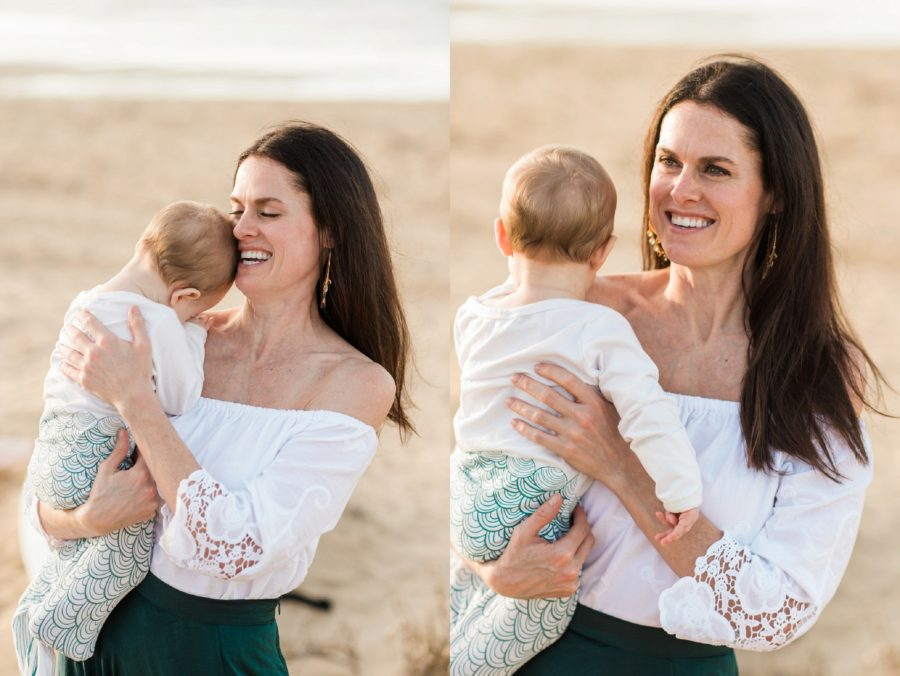 Woman smiling as she holds baby on beach, Virginia Beach Mom and Baby 6 Month Pictures