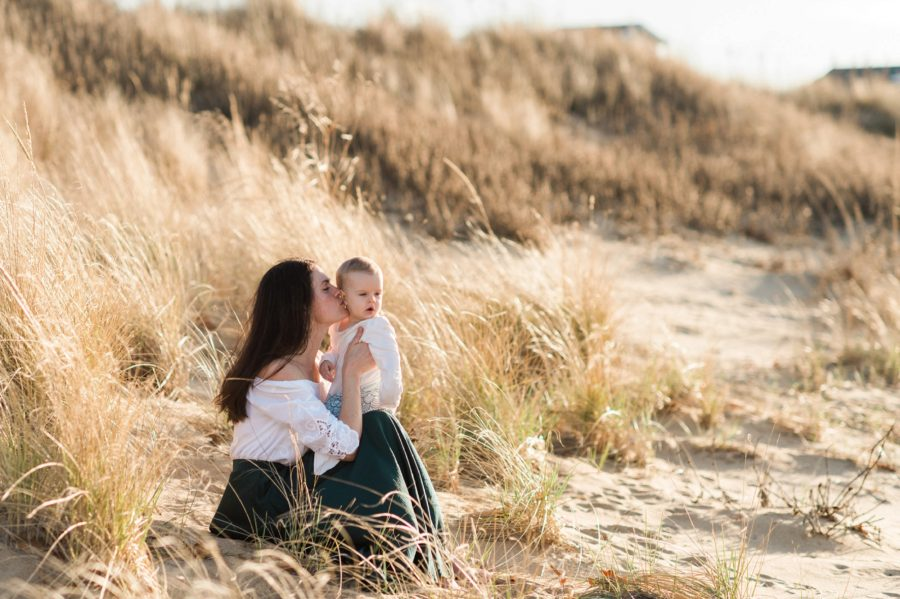 Portrait of mom kissing daughter in sand, Virginia Beach Mom and Baby 6 Month Pictures