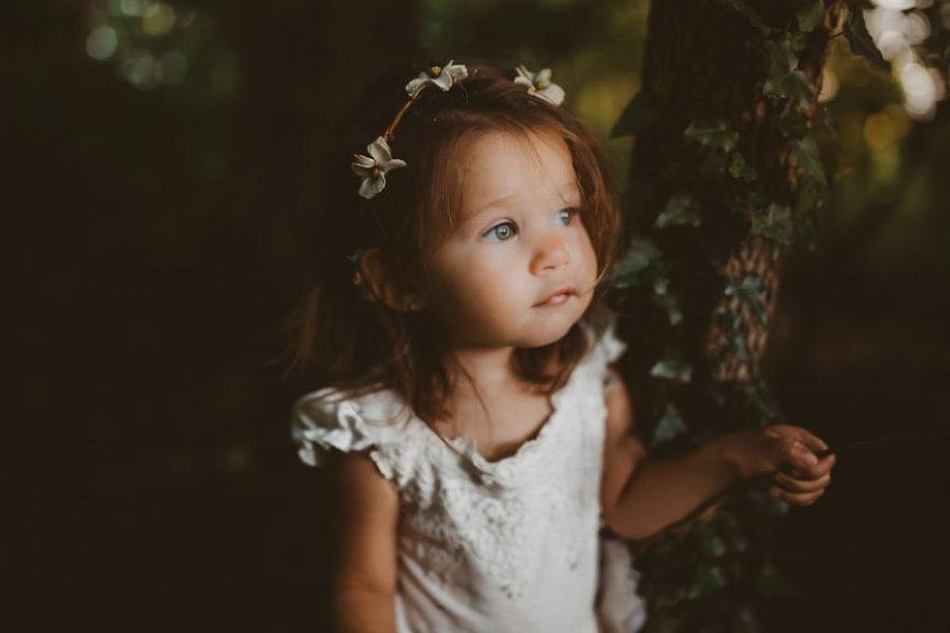 Portrait of girl sitting by tree, flower crown, Beyond the Wanderlust Daily Fan Favorites