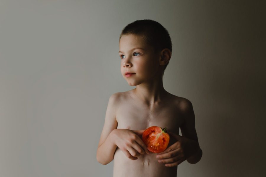 Boy holding tomato to show chambers of heart, Daily Fan Favorites on Beyond the Wanderlust