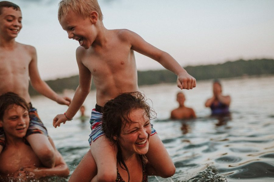 Kids on shoulders in lake, Casey Hurley Photography Daily Fan Favorite