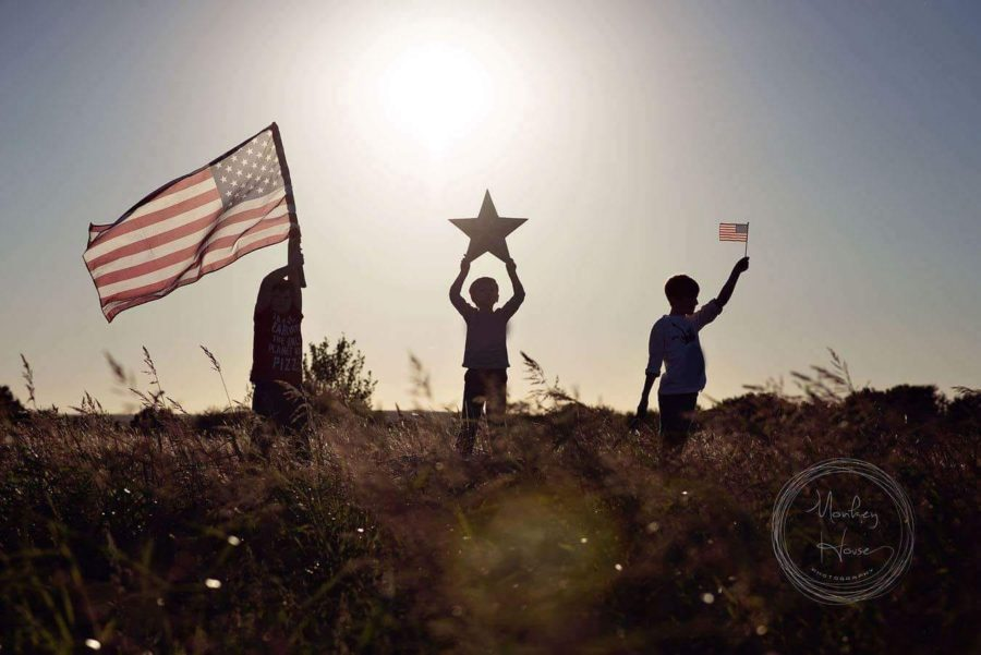 Silhouettes holding american flag, Beyond the Wanderlust Daily Fan Favorites