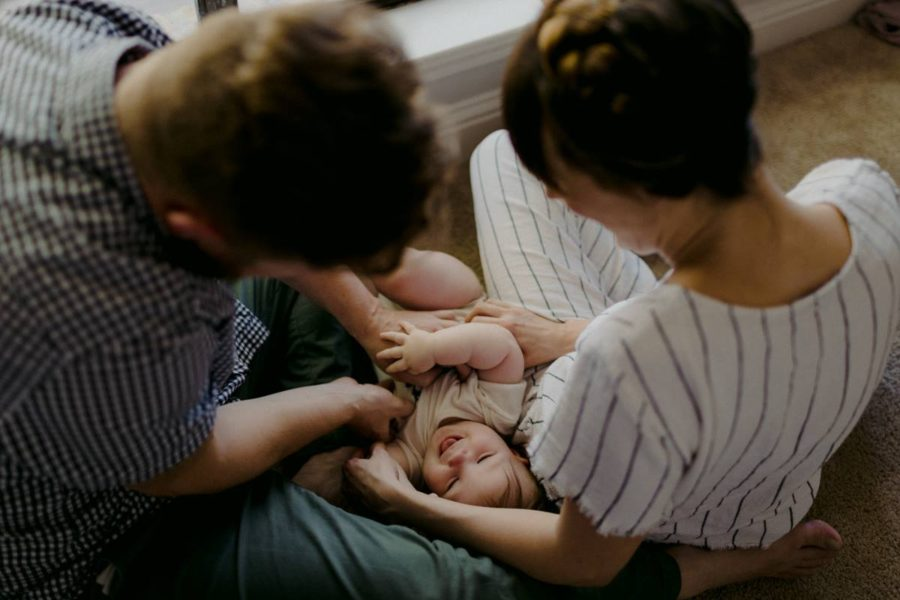 Overhead shot of family with baby laughing, Beyond the Wanderlust Daily Fan Favorite