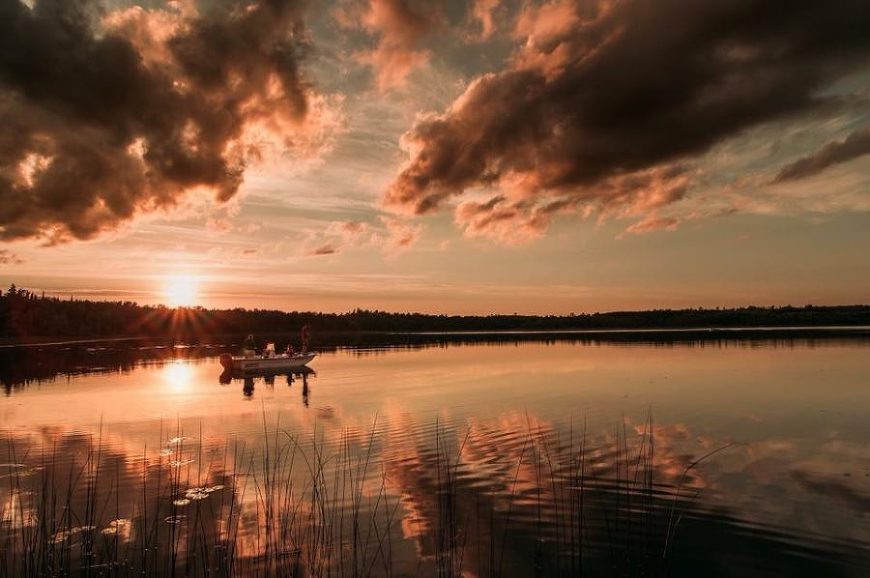 Boat on the lake at sunset, Beyond the Wanderlust Daily Fan Favorites