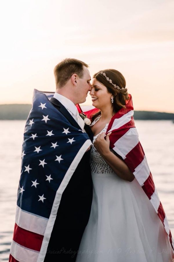 Couple touching noses, couple with american flag wrapped around them, Beyond the Wanderlust Daily Fan Favorite