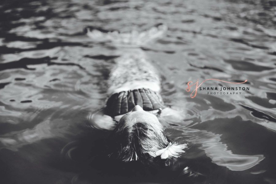 black and white photo of girl dressed as mermaid in water, Beyond the Wanderlust Daily Fan Favorite