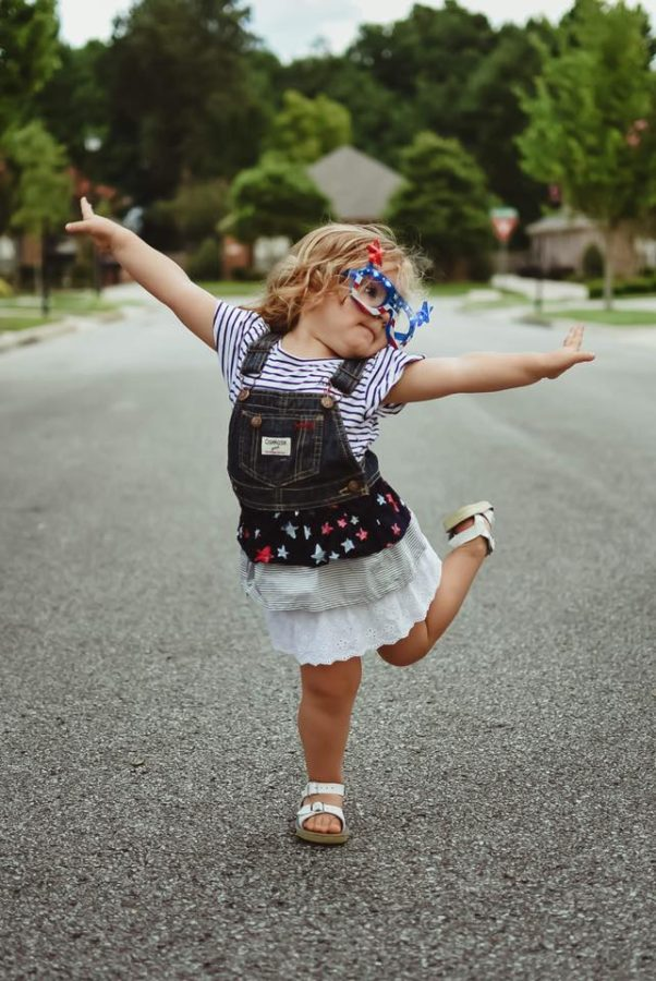 Toddler posing with leg up dressed for fourth of july, Beyond the Wanderlust Daily Fan Favorite