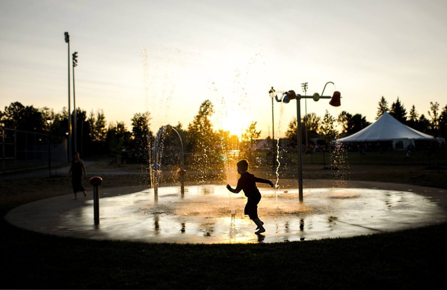 Silhouette of child running in splash pad, Beyond the Wanderlust Daily Fan Favorites