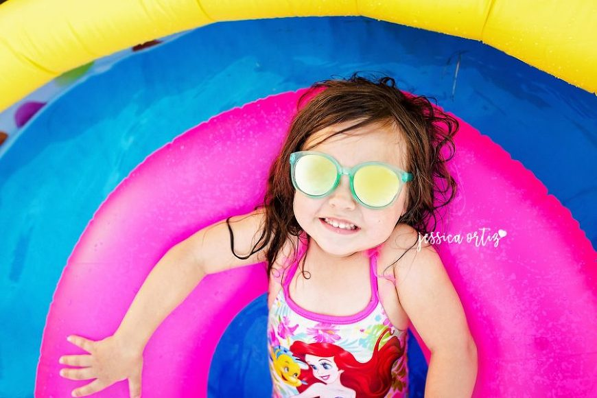 Overhead shot of child on pool floatie, Jessica Ortiz Photography Daily Fan Favorite