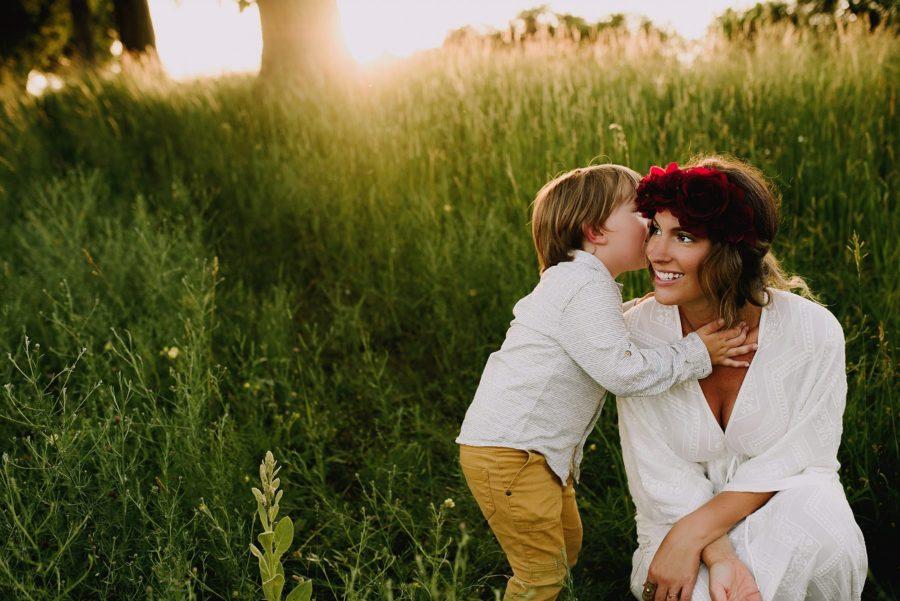 Boy whispering in his moms ear, Beyond the Wanderlust Daily Fan Favorites
