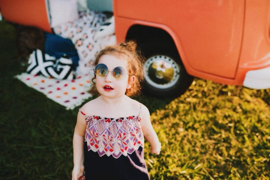 Portrait of girl in front of orange vw bus, Beyond the Wanderlust Daily Fan Favorites