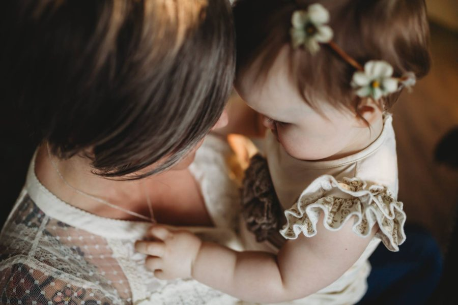 Overhead picture of mom and baby foreheads together, Beyond the Wanderlust Daily Fan Favorite
