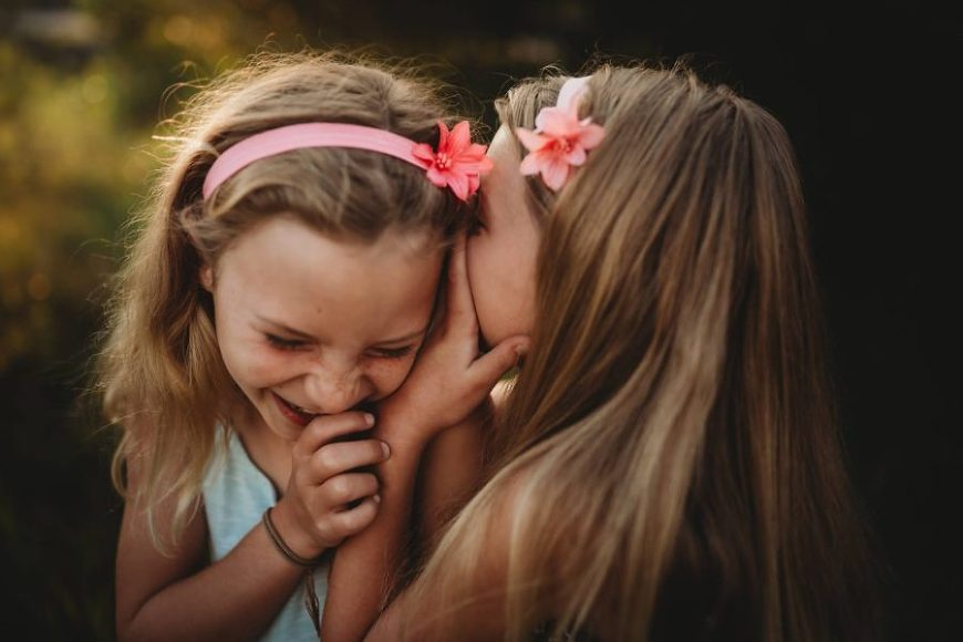 Sisters laughing telling secrets, Beyond the Wanderlust Daily Fan Favorite