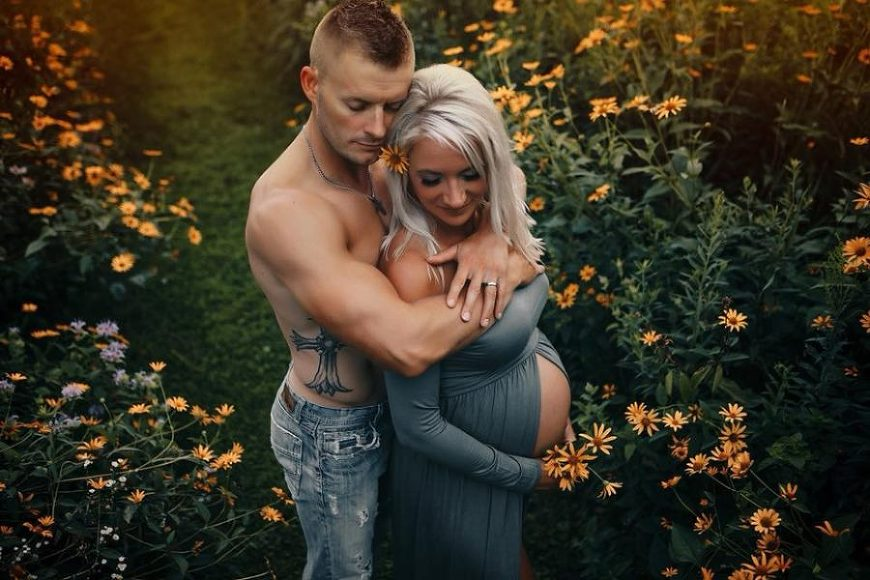Man standing behind pregnant woman with arms wrapped around her, L&H Photography Daily Fan Favorite