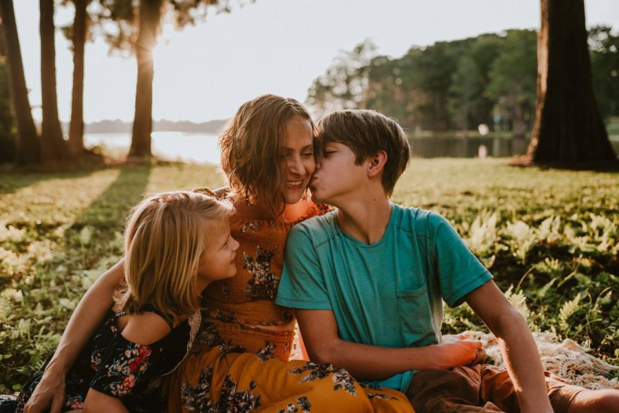 Family portrait boy kissing mom