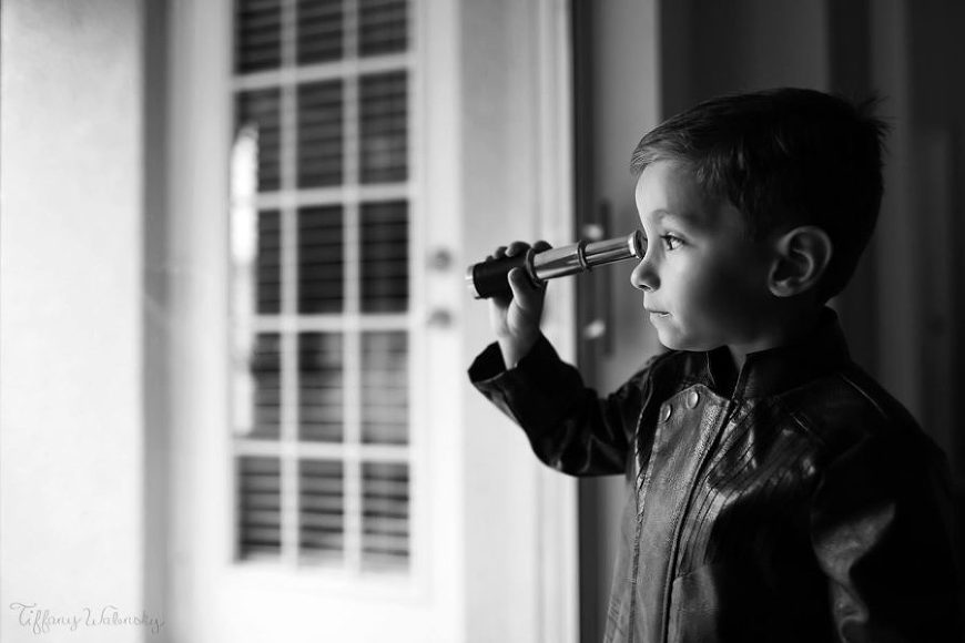 Boy looking through spy glass, Beyond the Wanderlust Daily Fan Favorite