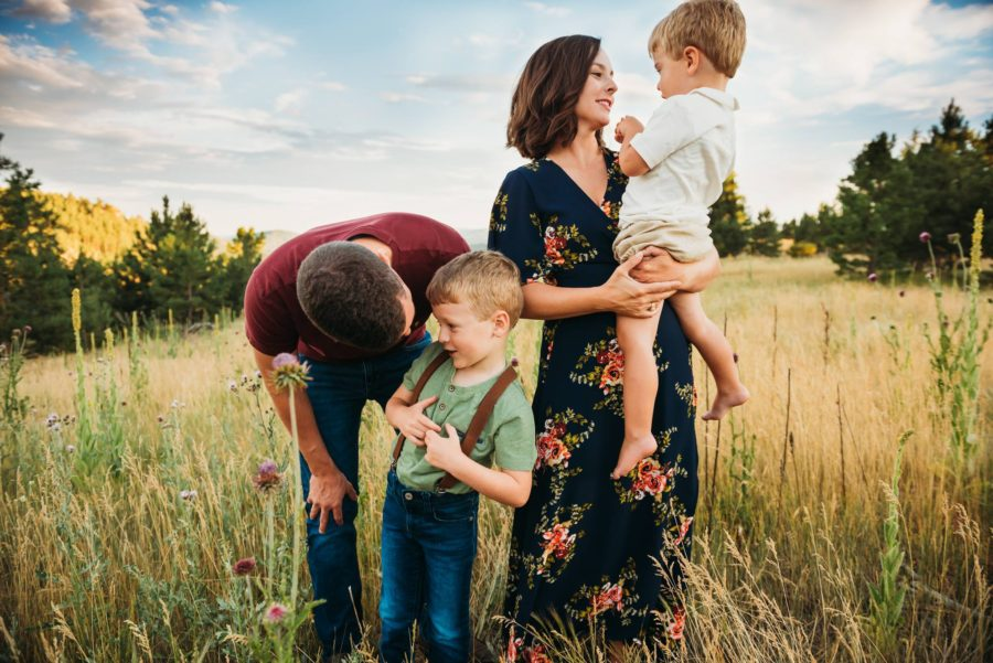 Man and woman in grassy field with two boys, Jamie Denholm Photography Daily Fan Favorite