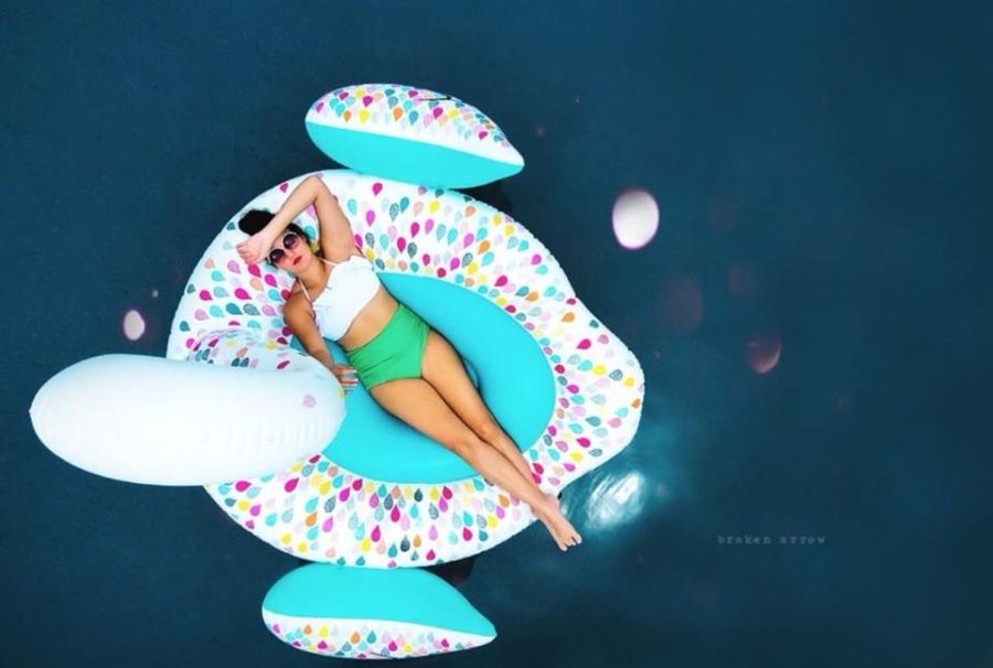 Overhead picture of woman lying on pool float, Broken Arrow Photography Daily Fan Favorite