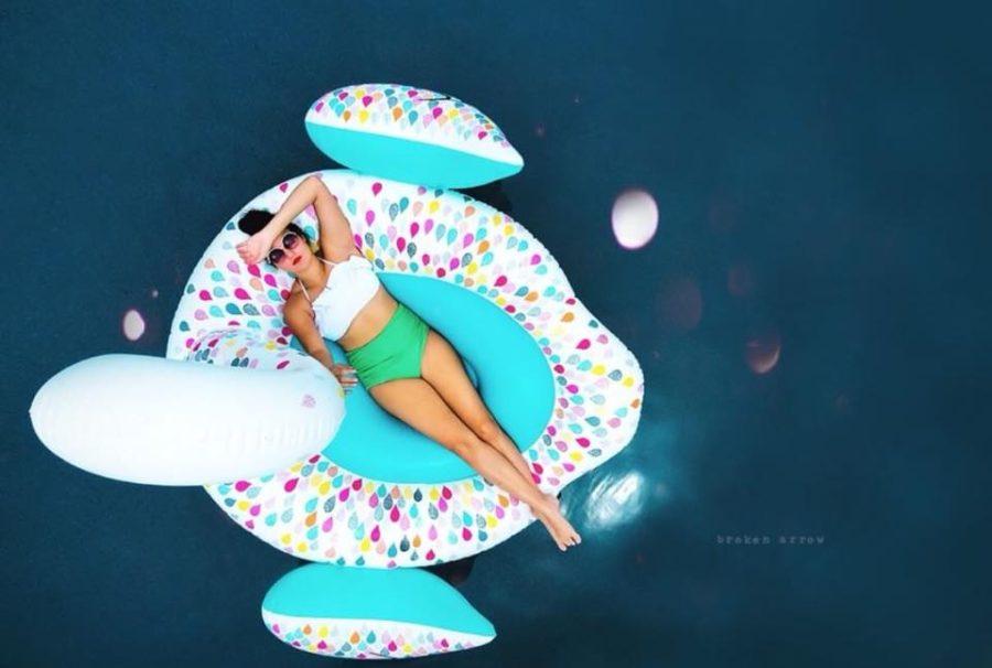 Overhead picture of woman lying on pool float, Broken Arrow Photography Daily Fan Favorite