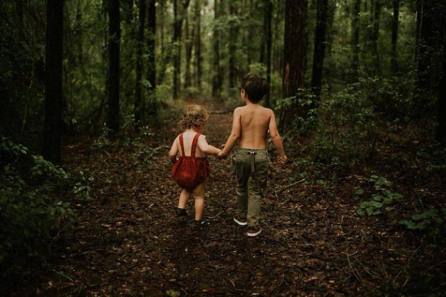 Kids holding hands walking through woods, Beyond the Wanderlust Daily Fan Favorite