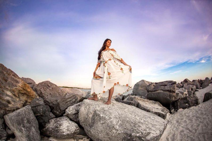 Woman standing rocks at beach under pretty sky, Beyond the Wanderlust Daily Fan Favorite